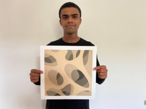 Student holding artwork